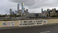 A climate emergency sign on a bridge in Melbourne, Australia