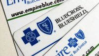 Empire Blue Cross Blue Shield health benefits cards are arranged for a photograph