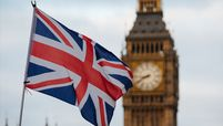 A British Union Jack flies in front of Big Ben