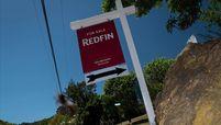 A For Sale sign stands in front of a single family home in San Rafael, Calif.