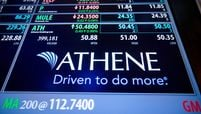 The Athene Holding Ltd. logo is displayed on a monitor on the floor of the New York Stock Exchange  on April 3, 2017