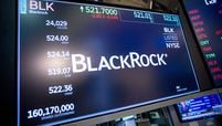 A monitor displays Blackrock Inc. signage on the floor of the New York Stock Exchange