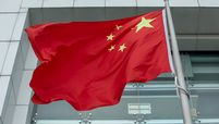 The Chinese flag flies in front of the Liaison Office of the Central People's Government in Hong Kong on May 22, 2020
