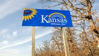 Welcome sign for the state of Kansas on the Missouri border