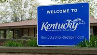 A sign welcoming visitors to the state of Kentucky near the Ohio border