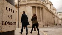 Pedestrians walk near the Bank of England in London