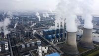 Emissions rise from smokestacks and cooling towers in China.