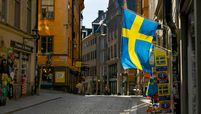 Swedish flags fly from a tourist souvenir shop in Gamla Stan in Stockholm on March 26, 2020