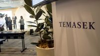Signage for Temasek Holdings Pte. is displayed during a news conference following the company's annual review in Singapore