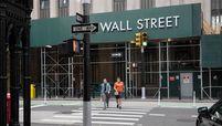 Pedestrians cross Broadway near the New York Stock Exchange on Sept. 14, 2020