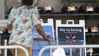 A 'We're hiring' sign is displayed outside a Walmart store in Torrance, Calif., on May 19, 2020