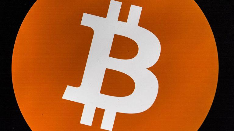 A bitcoin logo inside a bitcoin ATM kiosk in Barcelona