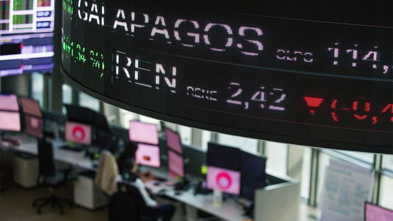 Screens display stock price information over the trading floor of the NYSE Euronext exchange in Paris