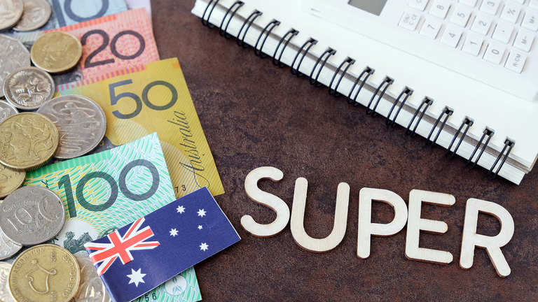 """Australian currency, flag, notebook and the word """"SUPER"""" on a desktop"""