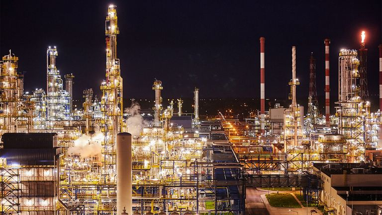 Pipework and refining towers at an oil refinery in Poland