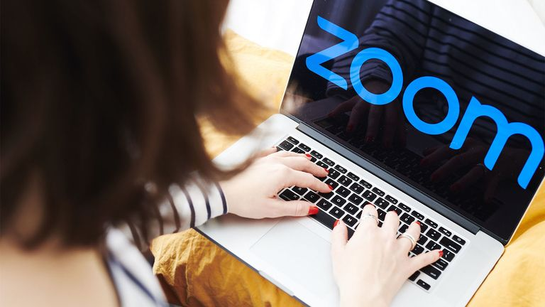 The logo for the Zoom application is displayed on an Apple laptop computer in an arranged photograph taken in Brooklyn