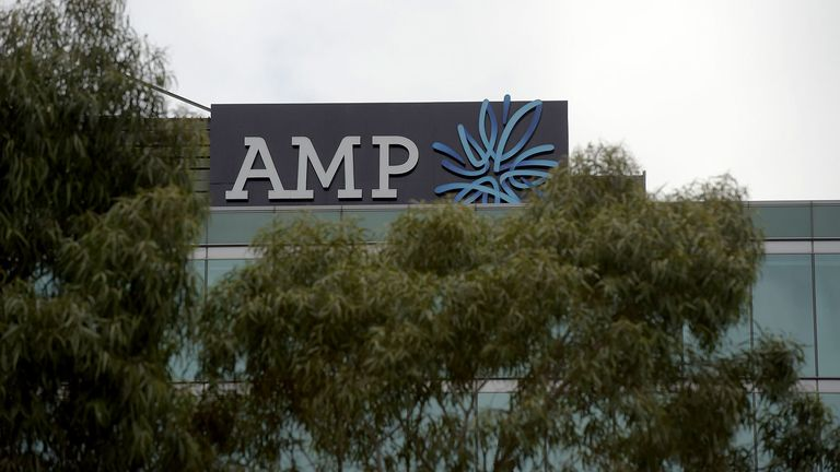Signage for AMP Ltd. adorns the top of a building in the Docklands area of Melbourne on May 10, 2018