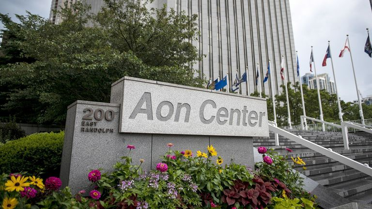 A sign is displayed outside the Aon Center in Chicago