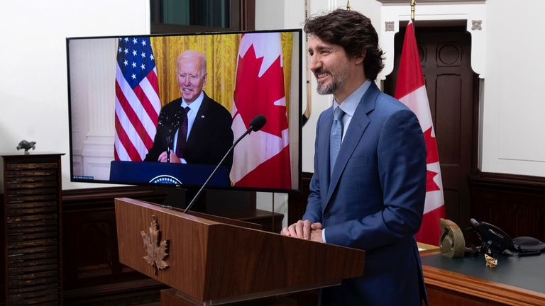Justin Trudeau, Canada's prime minister, smiles during a virtual joint news conference with U.S. President Joe Biden in Ottawa on Feb. 23, 2021