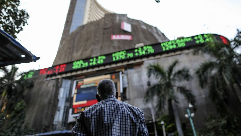 An electronic ticker board shows stock figures at the Bombay Stock Exchange in Mumbai, India