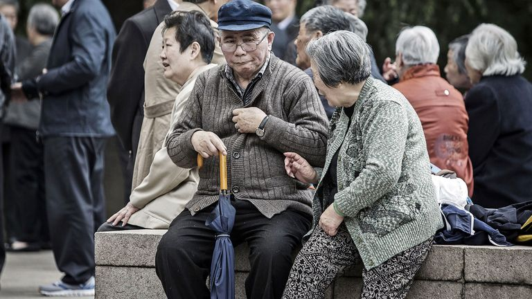 People sit and chat at Fuxing Park in Shanghai