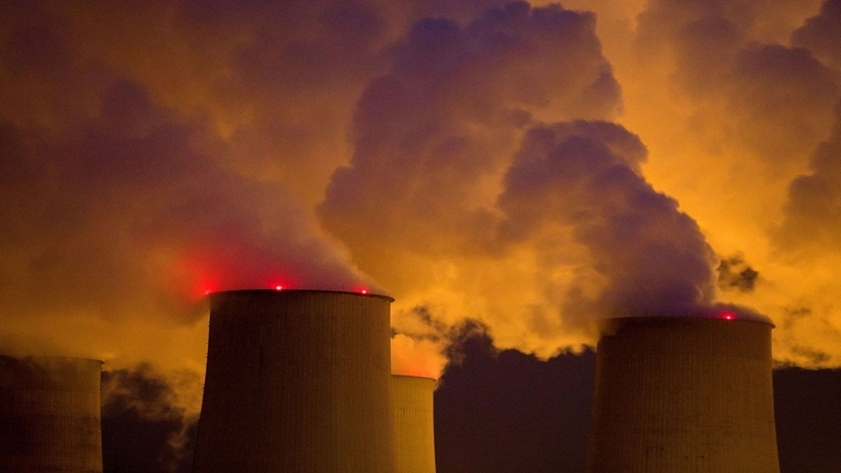 Emissions rise from a coal-fired power plant
