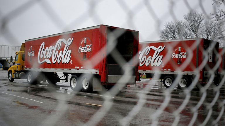 Delivery trucks parked outside a Coca-Cola Co. bottling plant in Lexington, Ky.