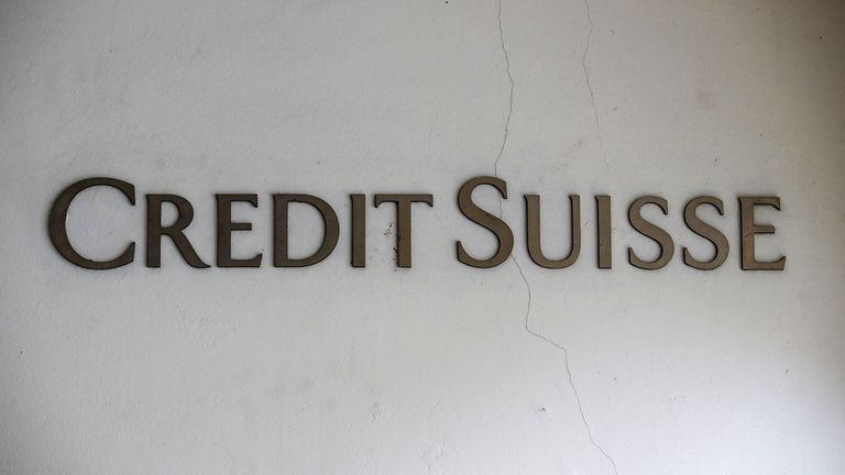 A Credit Suisse company logo on a cracked exterior wall outside a Credit Suisse Group AG bank branch in Murten, Switzerland,