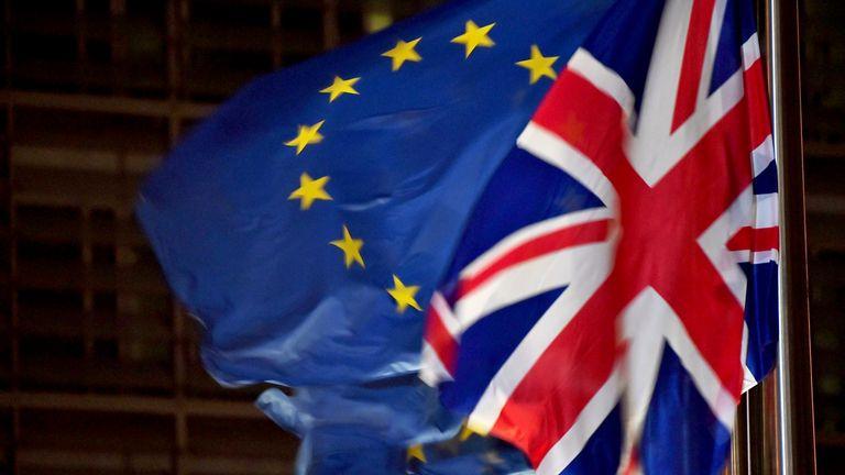 A U.K. national flag flies beside European Union flags outside the Berlaymont building in Brussels on Dec. 9, 2020