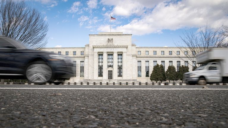 Vehicles pass in front of the Marriner S. Eccles Federal Reserve building in Washington on Jan. 22, 2021