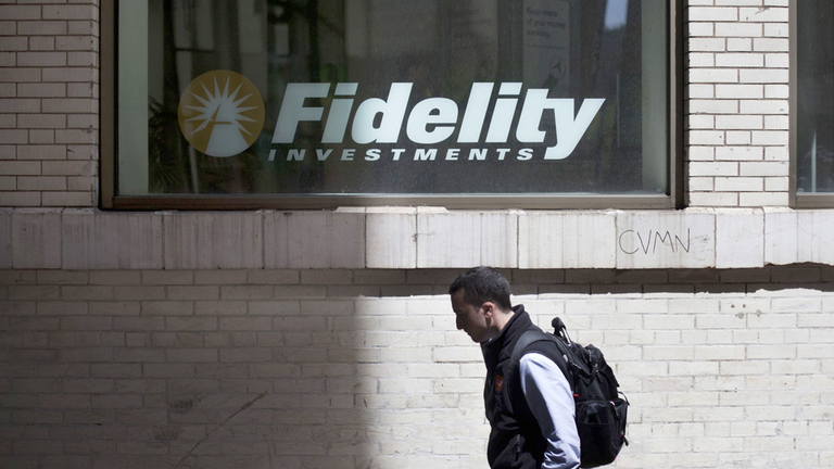 A pedestrian passes a Fidelity Investments branch in New York