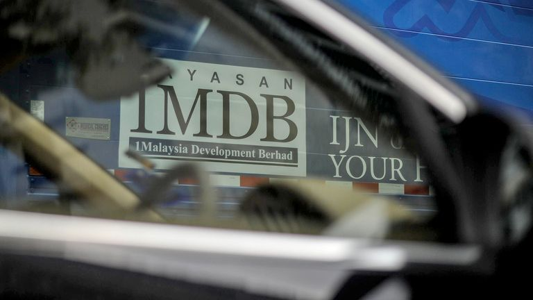 1MDB logo on a billboard at a construction site