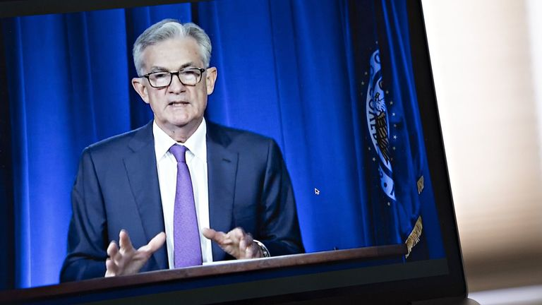 Jerome Powell, chairman of the Federal Reserve, speaks during a virtual news conference seen on a smartphone on July 29, 2020.