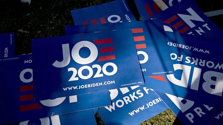 Campaign signs for former Vice President Joe Biden, 2020 Democratic presidential candidate, lay outside at an event in Clear Lake, Iowa, on Aug. 9, 2019