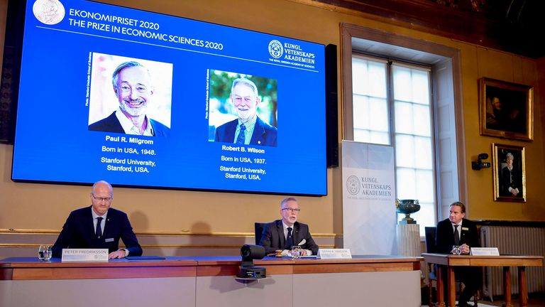 Images of Stanford University scientists Paul R. Milgrom and Robert B. Wilson are shown during the annoucement of the Nobel Memorial Prize in Economic Sciences in Stockholm on Oct. 12, 2020
