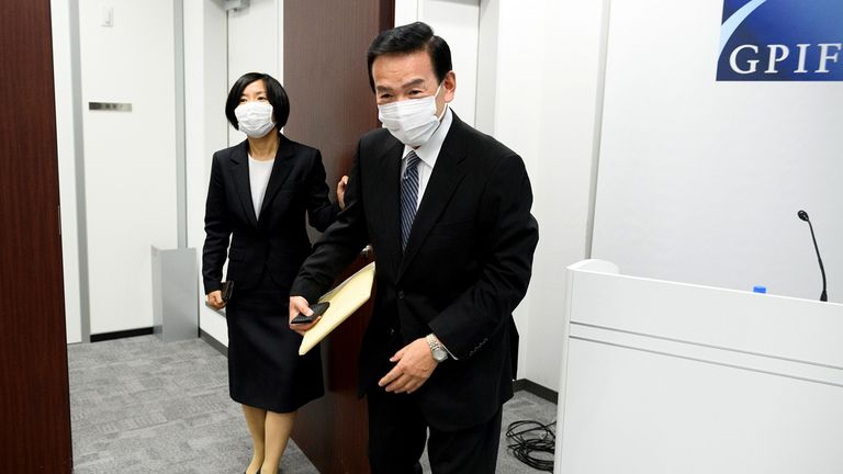 Masataka Miyazono, right, president of the Government Pension Investment Fund, leaves a news conference in Tokyo on July 3, 2020