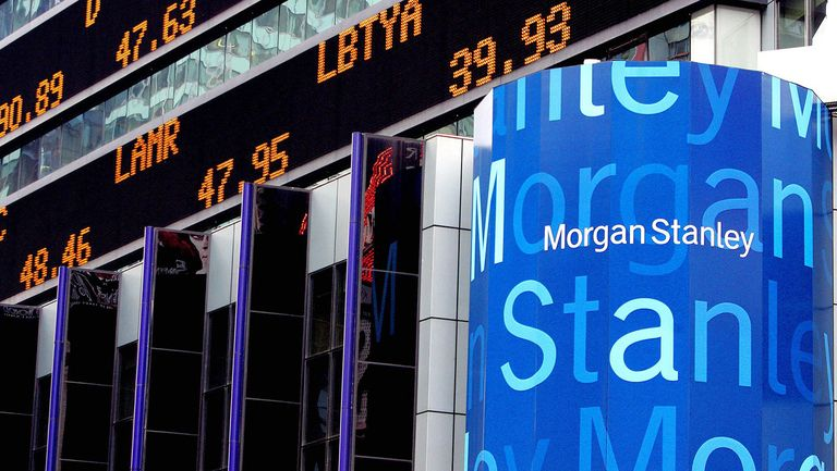 Morgan Stanley logo on buidling corner with stock ticker showing stock prices and movements
