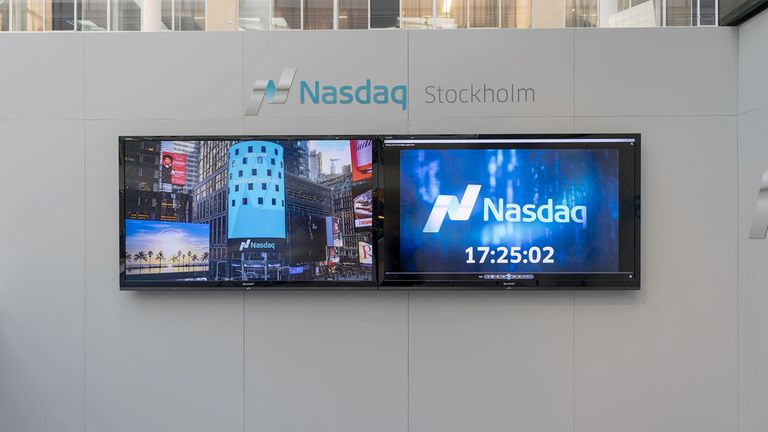asdaq signage sits on display above screens inside the Nasdaq Swedish Stock Exchange in Stockholm