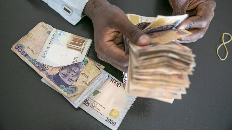 A clerk at a currency exchange bureau counts Nigerian naira banknotes in Maiduguri, Nigeria, on May 1, 2019