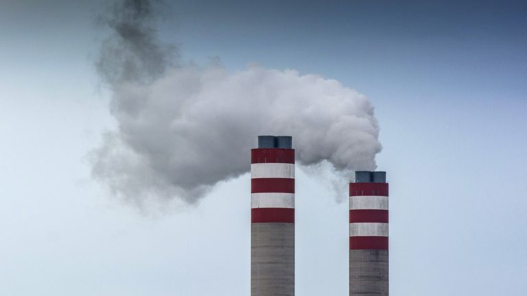 Vapor rises from chimney's at a power plant in South Africa