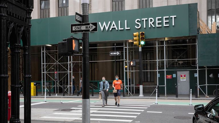 Pedestrians cross Broadway near the New York Stock Exchange on Sept. 14, 2020