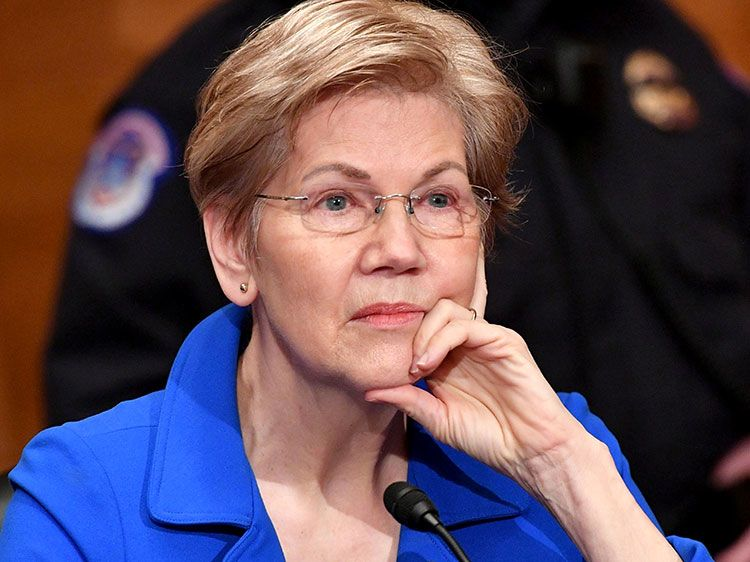 Sen. Elizabeth Warren, D-Mass., listens during a Senate Health, Education, Labor, and Pensions confirmation hearing for Marty Walsh, secretary of labor nominee for President Joe Biden, in Washington on Feb. 4, 2021