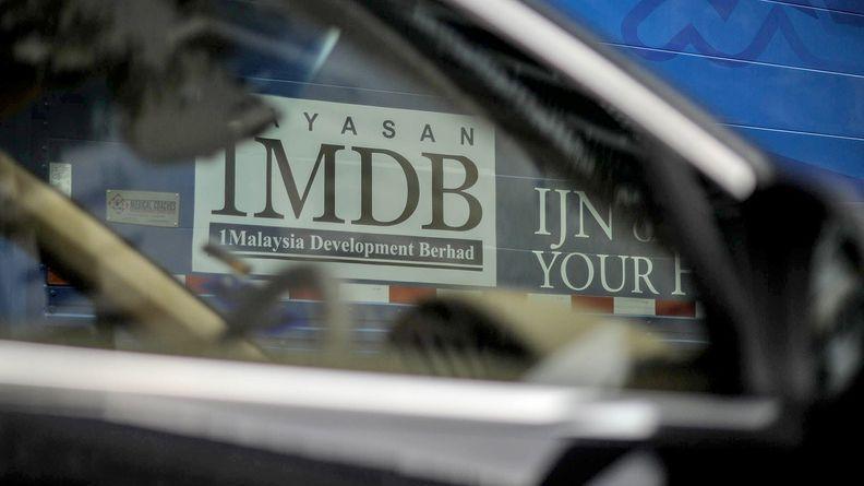 1MDB logo on a billboard at a construction site