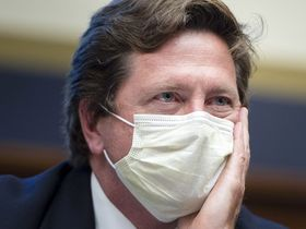 Jay Clayton, chairman of the Securities and Exchange Commission, wears a protective mask while listening during a House Financial Services Subcommittee hearing in Washington on June 25, 2020