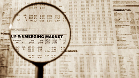 spyglass focused on emerging markets newspaper page