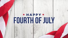 Happy Fourth of July text over white wood with American flags
