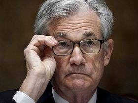 Jerome Powell, chairman of the Federal Reserve, adjusts his glasses during a Senate Banking, Housing and Urban Affairs Committee hearing in Washington on Sept 24, 2020.