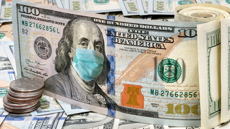 $100 bills with medical face mask, COVID-19 coronavirus in U.S.A.