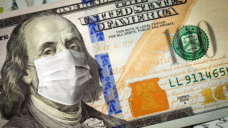 $100 bill with medical face mask on Ben Franklin