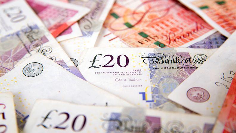 A stack of unbundled British pound sterling banknotes